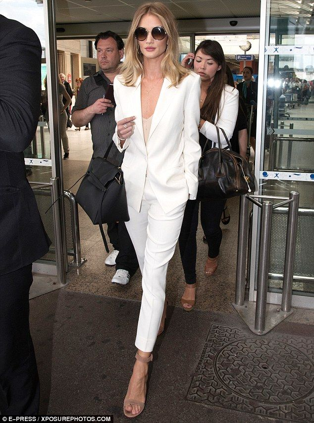 Here she comes: Rosie Huntington -Whiteley lead the glamorous arrivals at Nice airport, as she arrived in France on Wednesday to pay a visit to the 69th Cannes Film Festival