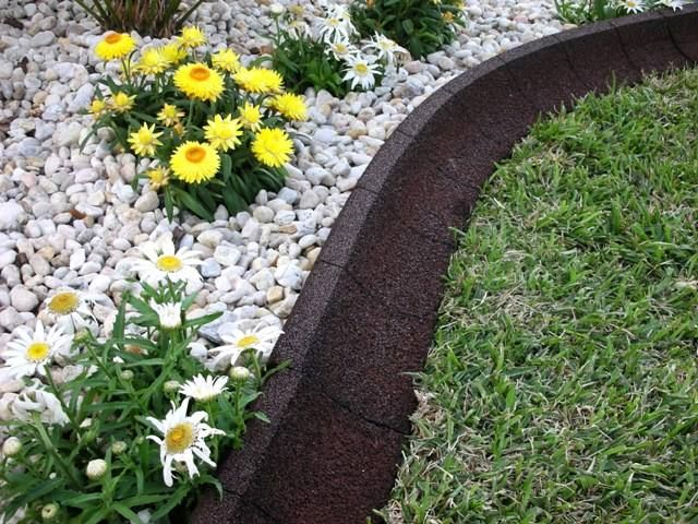 EcoBorder EarthCurb gives your yard or garden the artful look of a stone or poured concrete border   - yet with the flexibility of rubber from recycled tires