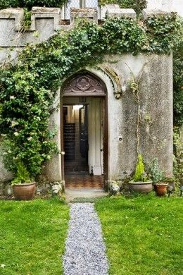 Beautiful ivy-covered arched door on Cloghan Castle in Ireland.