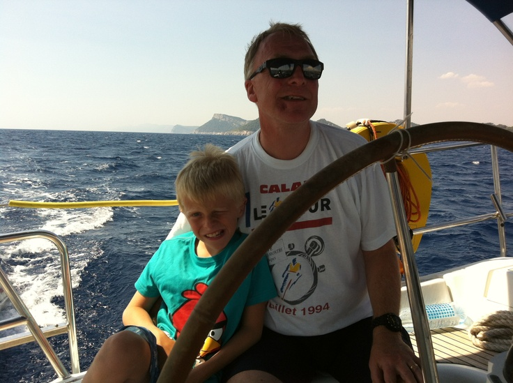 Zack with daddy at the helm.  Croatia, August 2012. Sunsail flotilla