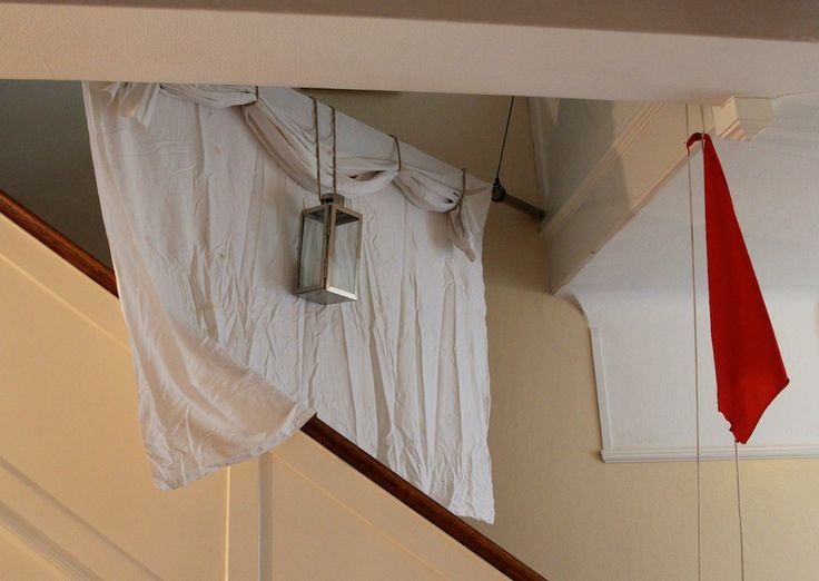 Still setting the scene with this sail with riding light and flag on the staircase.
