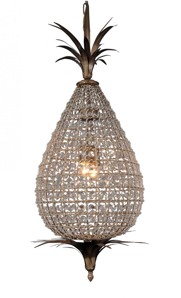 Crystal Pineapple Chandelier -Pineapples are a classical motif that seem timeless. Replicating the sparkling lanterns of 19th-century Morocco, our arresting pineapple-shaped chandelier is strung with multi-faceted crystals and bronze leaves.