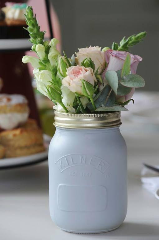 Painted Kilner jars with beautiful flowers - rustic wedding decor!