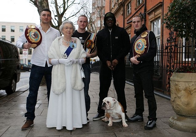 Fight club: Queen Elizabeth look-alike Mary Reynolds poses with boxers Nathan Cleverley, George Groves, Dereck Chisora and Ricky Burns