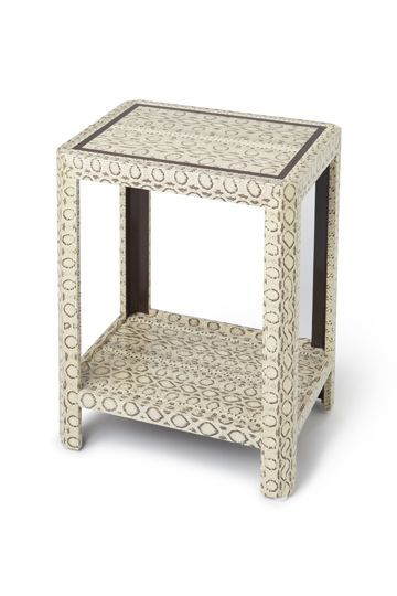 Snake skin covered occasional table at www.chicone.com