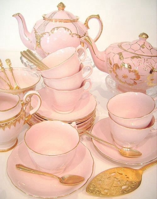 Beautiful pink tea set with gold trim.