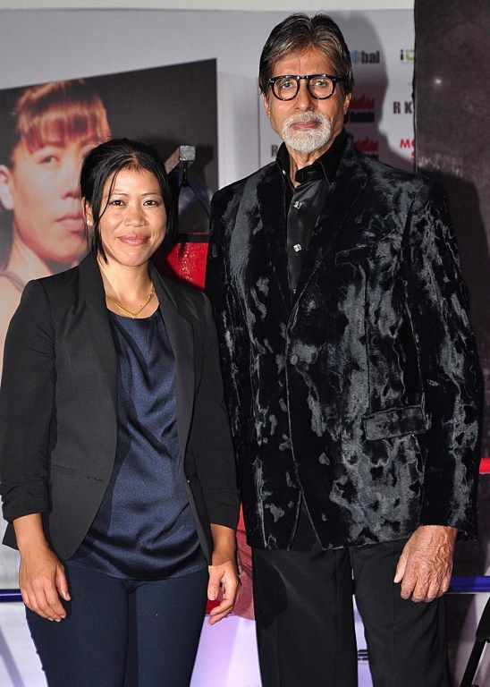 Amitabh Bachchan and Mary Kom pose for the cameras at the launch of Kom's autobiography called 'Unbreakable'. #Fashion #Style #Handsome #Bollywood #Beauty