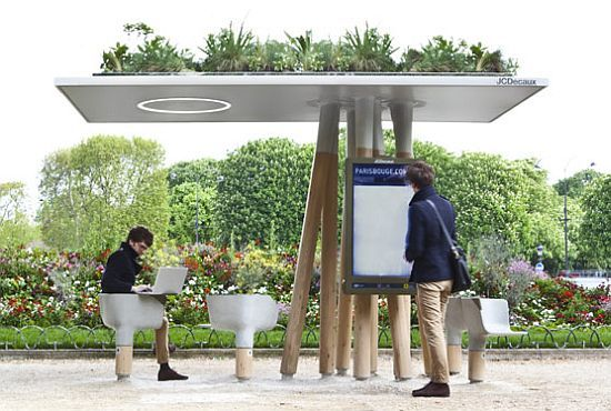 Hey, Big Blue, check out this bus stop: Escale Numérique intelligent street furniture is all green and natural. Almost as little seating as yours, but far more attractive and sheltering.