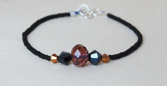 Black beaded bracelet with swarovski crystals on by AasJewelry