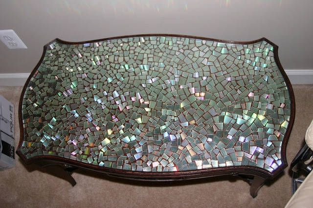 2.) A Coffee Table - This tabletop made entirely out of cut up CDs is pretty mesmerizing. Just cut them up and glue them to the surface.