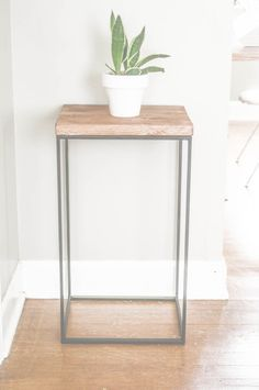Holy cow. This girl is a genius. Just try and guess what this beautiful side table used to be! It will shock you!