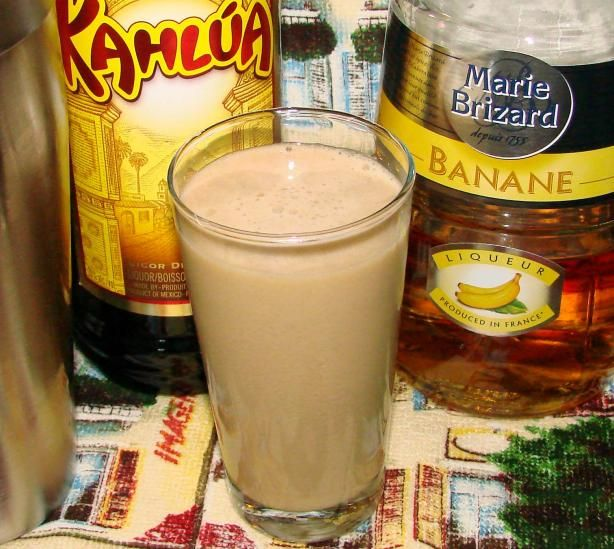 1 oz banana liqueur - 1 oz Kahlua - 1 oz half-and-half - pineapple juice. Add the banana liqueur, Kahlua and half-and-half into a tall glass 1/2 filled with ice, fill the rest of the way with pineapple juice. Stir to combine. Garnish with cherries.