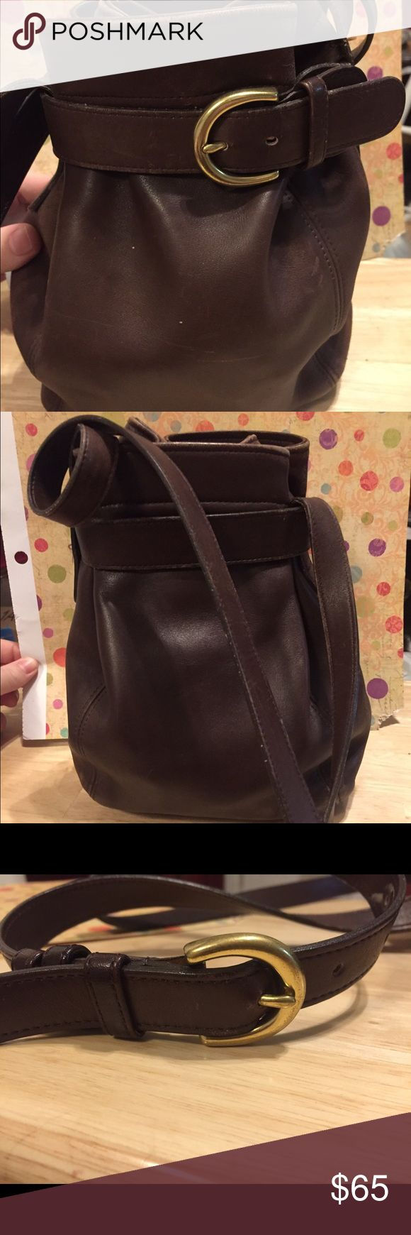 Rare COACH Legacy Brown Leather Bucket Bag Vintage COACH Legacy Brown Bucket bag. In great vintage condition. A hard to find bag.                                     Width 9 inches Height 10 inches Strap Drop 23 inches From a smoke free home. Coach Bags Satchels
