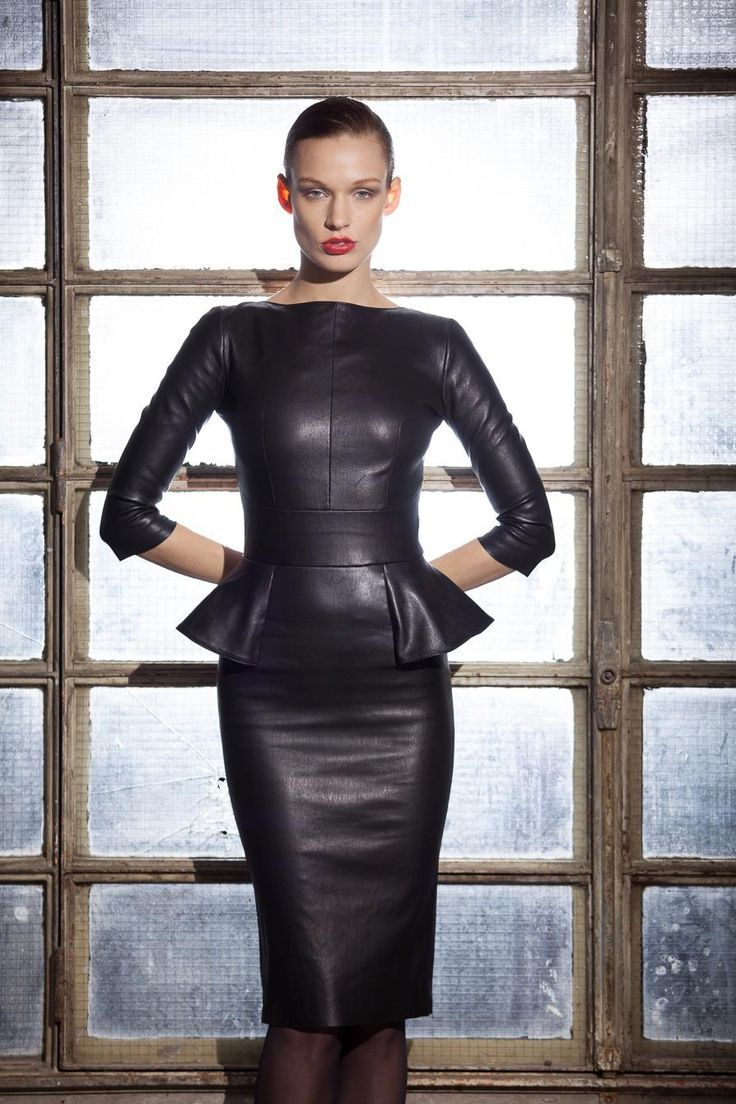 Leather peplum dress with three-quarter sleeves and structured fit.