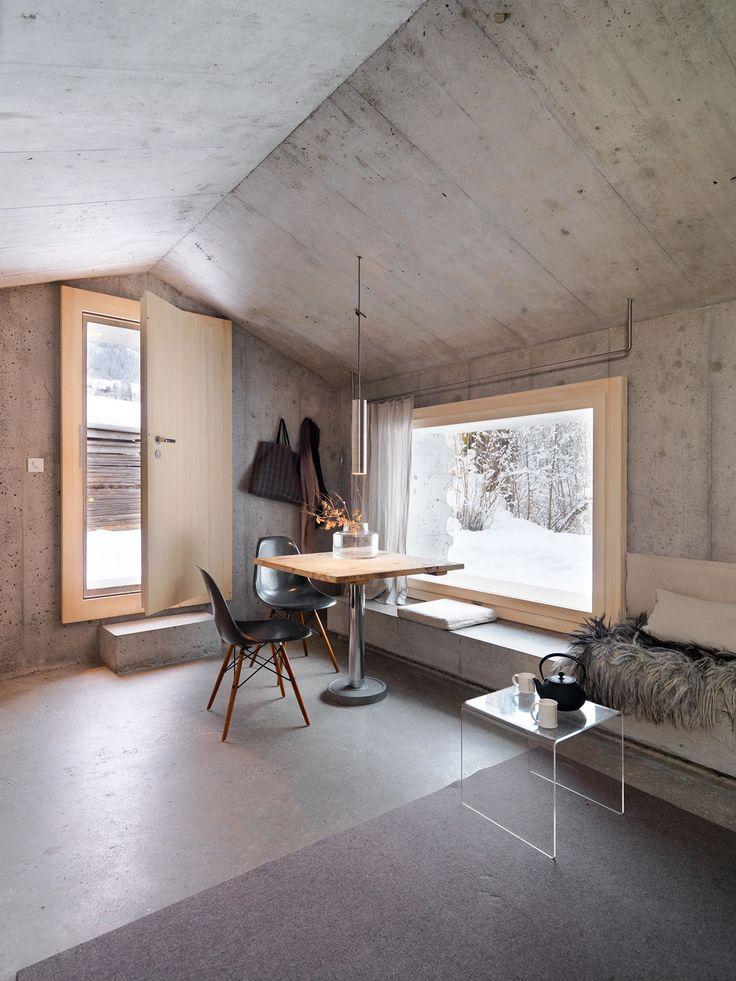 Window seat in Concrete Cabin in Switzerland – Gravity