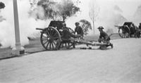 Firing canons in unknown location, ca. 1939.