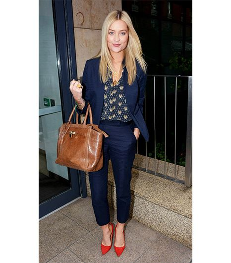 Laura Whitmore in a stunning suit. Even shorter women can pull off a cropped trouser leg; just note how the Irish TV presenter paired her suit with a classic pump, which lengthens the leg by exposing the top of the foot.