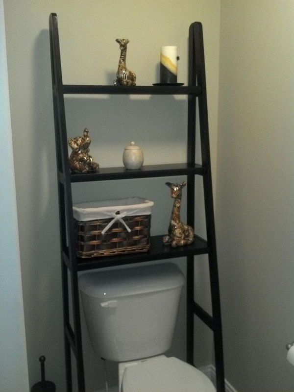 Take a ladder shelf and left out the bottom 2 rows to fit perfectly over the toilet. This could make for extra storage space without looking too bulky. http://hative.com/over-the-toilet-storage-ideas-for-extra-space/