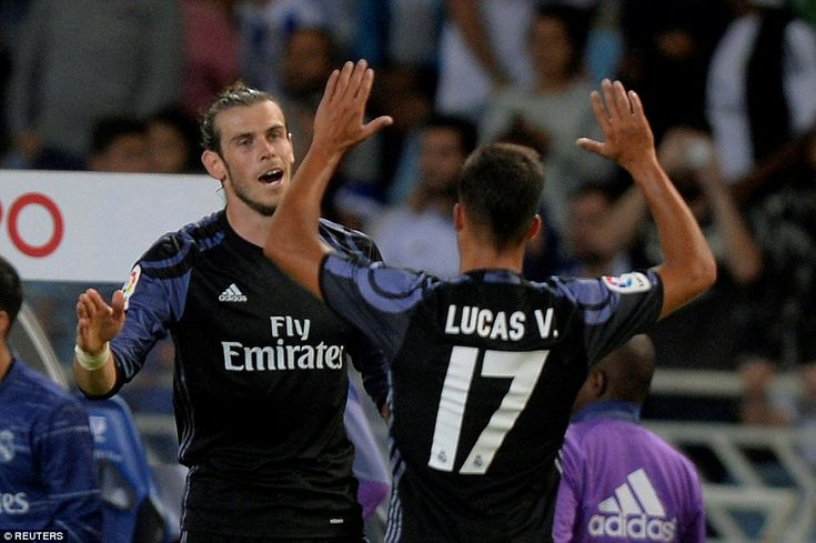 Bale is joined by Lucas Vasquez after he sealed a 3-0 victory seconds before time at the Estadio Anoeta