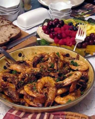 New Orleans Style barbecue shrimp, just as they make it at the famous Deanie's restaurant (or as close as we can get) sets the mood for a rollicking Mardi Gras party.