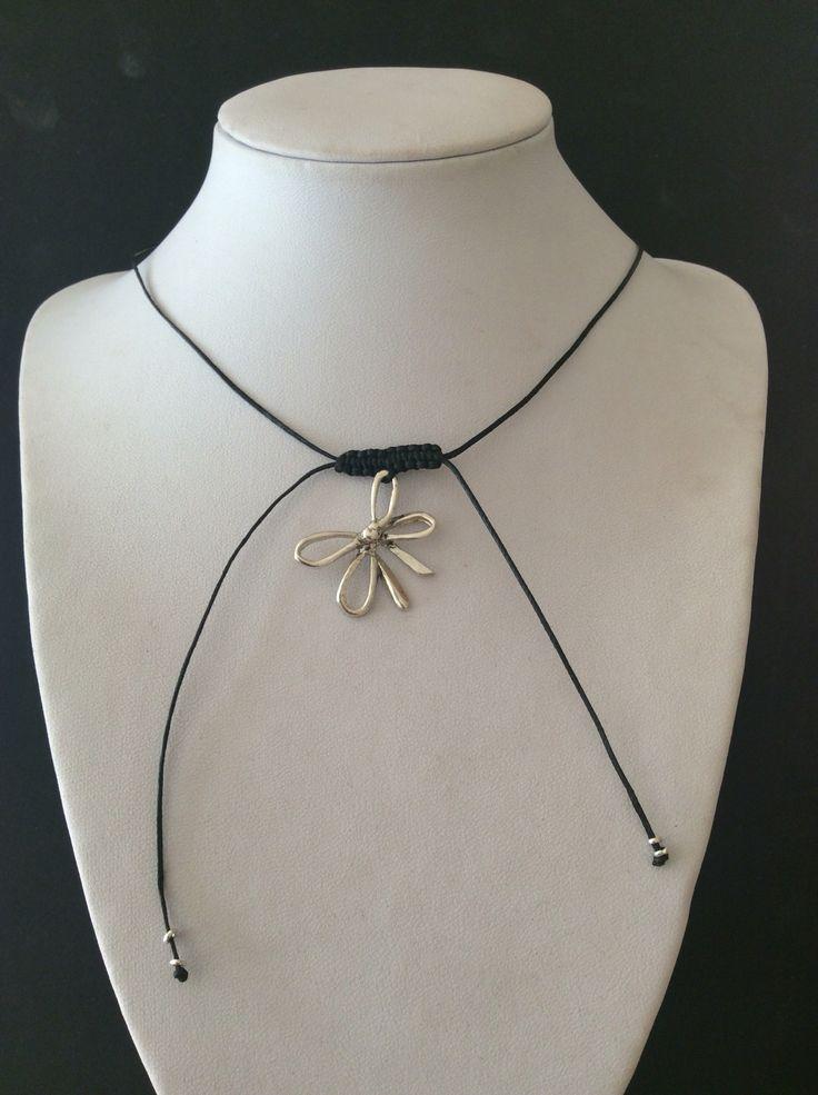 The Ribbon, silver on black string