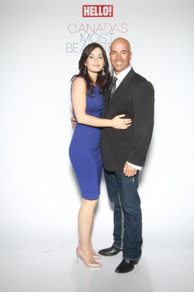 Erica Durance, with husband David Palffy, posing at the Hello Magazine party to honor the 50 Most Beautiful People of Canada, 2012, where Erica made the list.