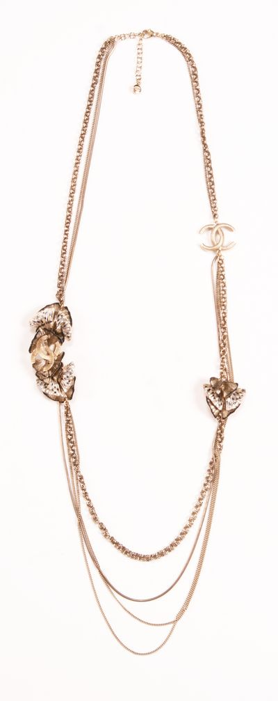 Chanel vintage multi-chain . Love anything that looks like rose gold.