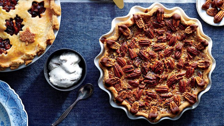 """Surprisingly, pecan pie is a relative latecomer to the Southern table. Recipes for milk-custard-based pecan pies can be found as early as 1886, but it wasn't until the 1930s when promotional recipes for a syrup-based pecan pie appeared on the labels of Karo syrup bottles that its popularity soared. Twenty years later, Marion Brown's landmark Southern cookbook proclaimed it """"the South's most popular pie."""" Our latest twist? A stellar riff on the flavors of German chocolate cake, for which the…"""