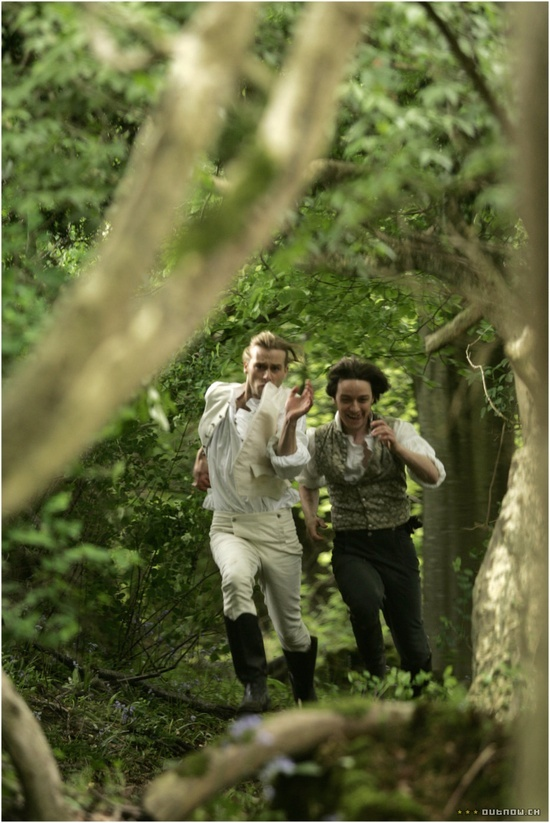 Tom LeFroy (James McCavoy) running through a forest with a pretty attractive friend