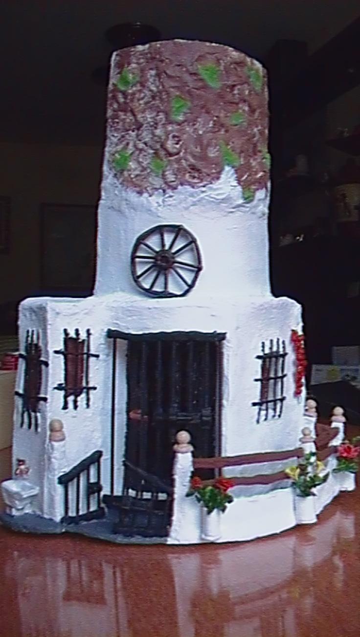 sandylandya@outlook.es Teja con fachada de una casa cueva.
