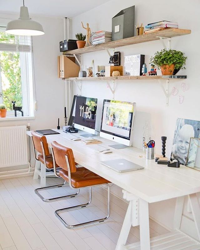 Shared #workspacegoals + regram from Linda + Bart @linenhoningh in The Netherlands ✨✨ The final pick in our workspace for two feature is the home office of Linda + Bart, a makeup artist + photographer blogging together at Lin & Honingh  If you like wood, white + vintage you'll love their beautiful home. We're  for the warm tones in this workspace + love how the tan leather chairs pop against the white desk  Thanks Linda + Bart for inspiring us with your cozy workspace for tw...