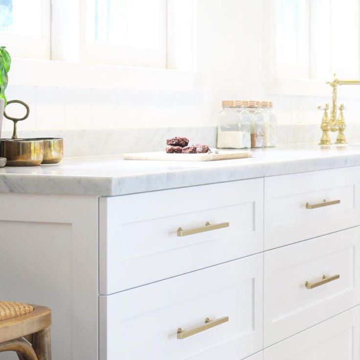 White Kitchen With Brass Hardware Photo Design And