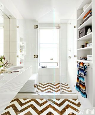In a New York City bathroom designed by Alla Akimova, the walls and surfaces are made of glass. But in this luminous room, the drama is really on the floor tile.