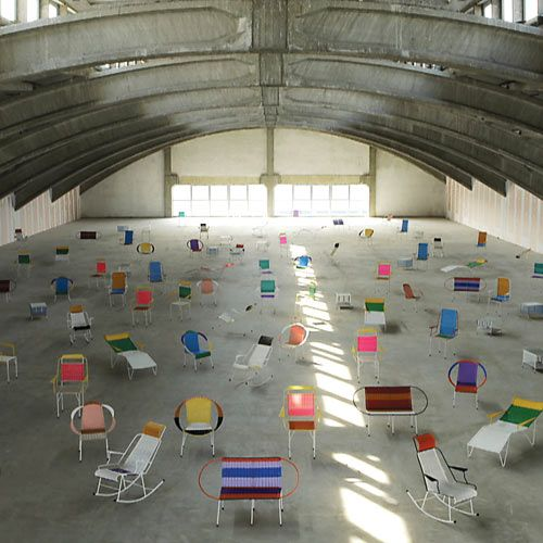 Marni Chairs at Milan Design Week.    The chairs are made in the traditional Colombian style using a metal structure and woven multicolored PVC threads on the backs and armrests. Marni designed the patterns and color combinations, but left the creation in the hands of the ex-prisoners.