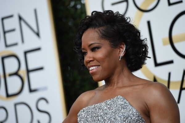 Regina King Photos Photos - Actress Regina King arrives at the 74th annual Golden Globe Awards, January 8, 2017, at the Beverly Hilton Hotel in Beverly Hills, California.  / AFP / VALERIE MACON - 74th Annual Golden Globe Awards - Arrivals