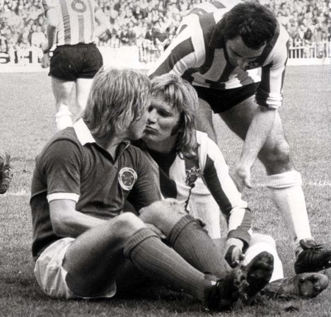 Give us a kiss. Tony Currie (Sheff Utd) & Alan Birchenhall (Leicester).
