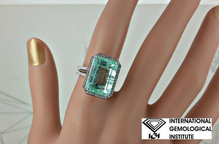 IGI 1106 ct natuurlijke smaragden en diamanten ring in 18 kt wit goud - Ringmaat: 6 (USA)  Details voor centrum stone:Edelsteen: Natuurlijke Colombiaanse EmeraldVorm: rechthoekigKaraatgewicht: 10.04 ctKleur: LichtgroenTransparantie: transparantZijde diamant detailsCarat: 1.02 ctKleur: EDuidelijkheid: SI1Vorm: rondeMetalen detailsItem: ring van de diamant vanGouden type: 18 kt massief witgoudGouden gewicht: 48 gRing van grootte: 6 (USA)Vergroten/verkleinen is kosteloosStijlnummer: nl-01FedEx…