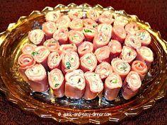 ham roll ups. Think sliced ham 1--8 oz package of cream cheese finely chopped green onions to taste1 tsp of Garlic powder