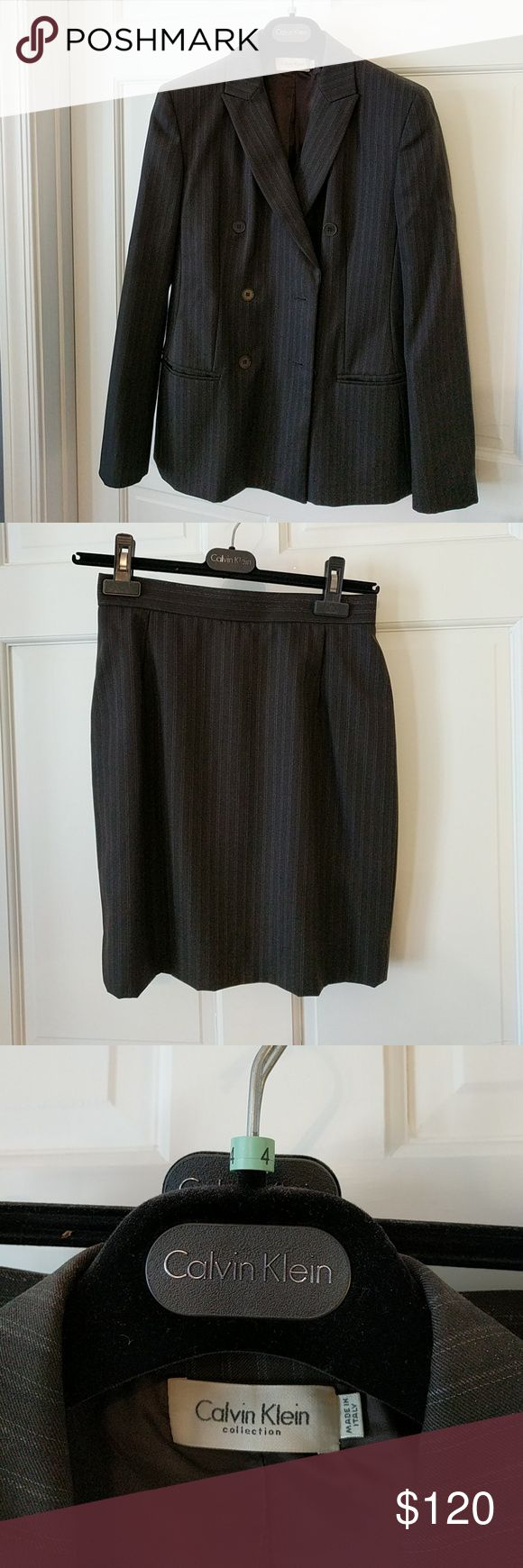 Calvin Klein 100% Wool 2 Piece Suit Calvin Klein 100% Wool suit with double breasted jacket as skirt. Black pinstripe. Size 4. Calvin Klein Collection Skirts Skirt Sets