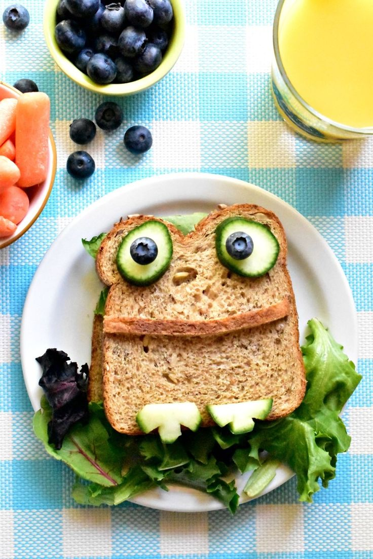 Froggy Sandwich ~ This simple sandwich is all about building on top of what your little one already loves, be it peanut butter and jelly, hummus and veggies, or whatever lunch meat they might like. Just build your frog on top of what you'd already serve them and see how easy it really is to recreate a frog right in front of their very own eyes.