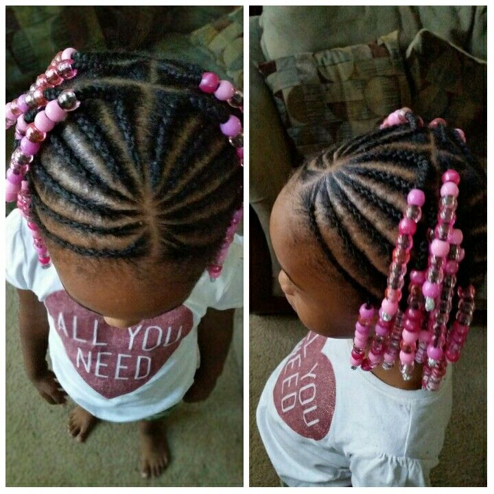 Protective style, cornrows, natural hair. Beads adds pizzazz to cornrows.