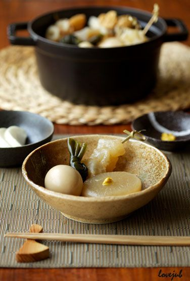Oden おでん -  Japanese winter dish consisting of several ingredients such as boiled eggs, daikon radish, konnyaku, and processed fish cakes stewed in a light, soy-flavoured dashi broth.