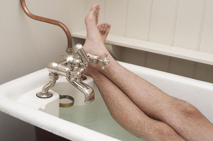Free Stock Photo: Man enjoying a hot relaxing bath in a vintage bathtub with his…