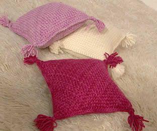 Almohadones tejidos en bastidor