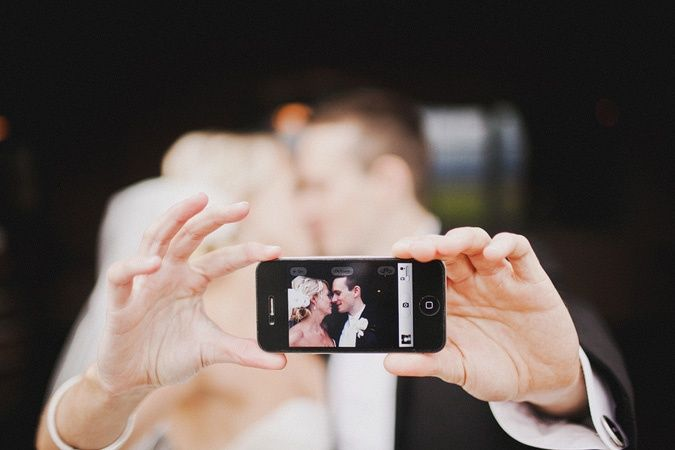 smartphone and iPhones are certainly a major part of our lives. Using them as a prop in a wedding photo shoot is a great idea!