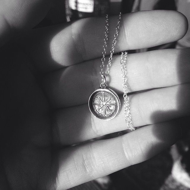 Customer photo of her new #plumandposey Windrose wax seal necklace.