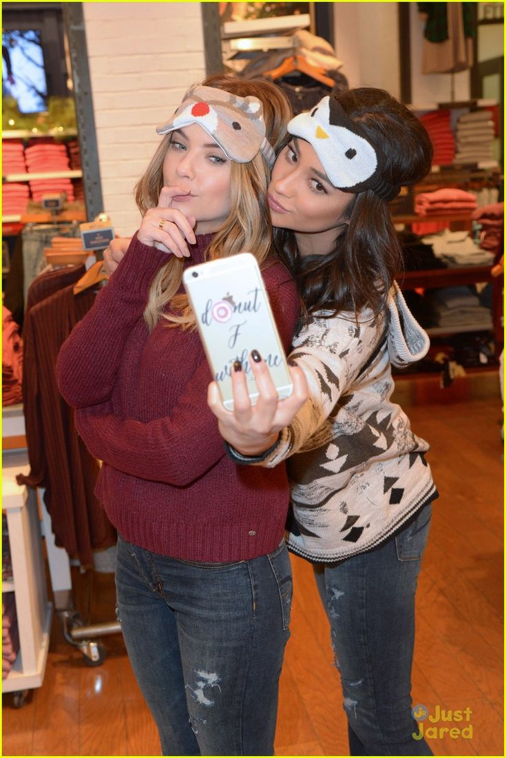 Shay Mitchell & Ashley Benson Have Holiday Shopping Spree At American Eagle Outfitters: Photo #903772. Shay Mitchell and Ashley Benson get close together for a fun selfie during their holiday shopping excursion at American Eagle Outfitters in Hollywood on Tuesday…