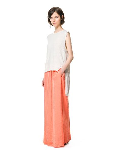 Long skirt with assymetric top