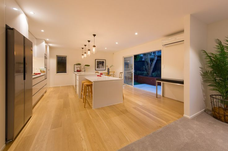 a modern whtie kitchen by KMD Kitchens Auckland