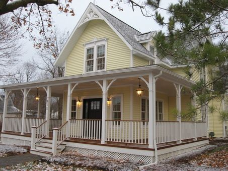 I love the exterior of this house! I even love the color scheme - yellow with white trim and navy blue door. The wrap around porch is a must on my dream house!